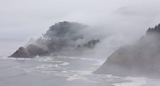 Oregon, USA. Fog shrouds the Heceta Head lighthouse on Oregon's rugged coast.
