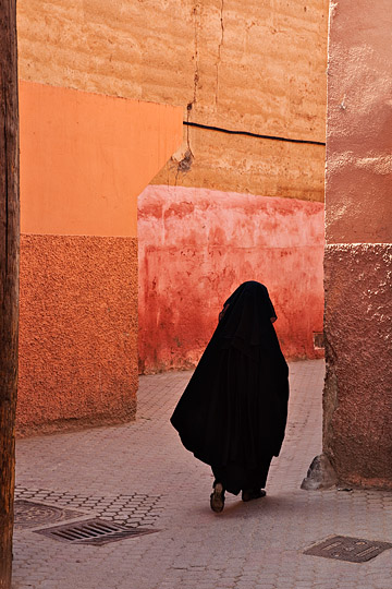 Woman walking in Medina, Marrakech, Morocco