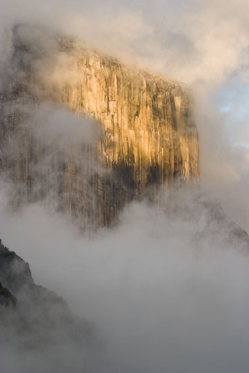 Fog shrouds El Capitan, notable rock formation in Yosemite National Park, CA.