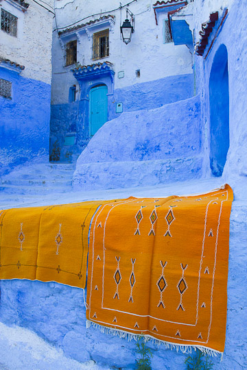 Orange Tapestries on Blue wall, Chefchaouen, Morocco