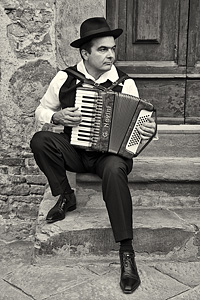 Man playing an accordion, Italy.