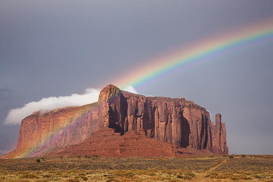 Rainbow over red rock butte, Monument Valley, Utah.